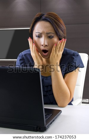 young woman frustrated because accounts are overdrawn - stock photo