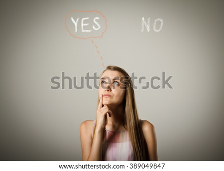 Young woman full of doubts and hesitation. Yep concept. Young woman is doing something. - stock photo
