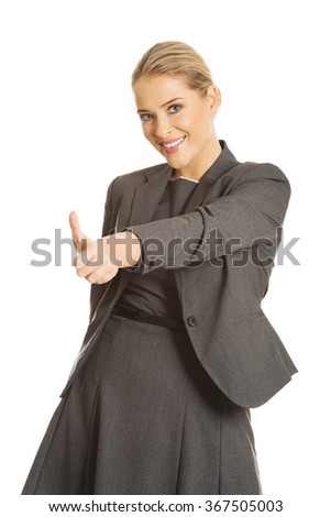 Young woman gesturing thumbs up - stock photo