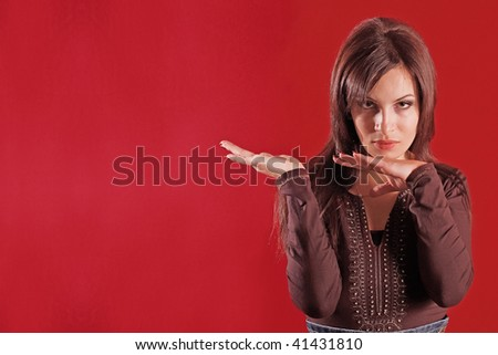 Young woman gesturing with hands - stock photo