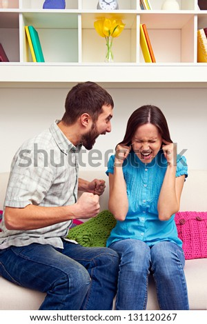 young woman gets earful from an annoyed man - stock photo