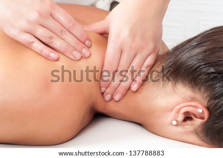 Young woman getting massage in massage salon. - stock photo
