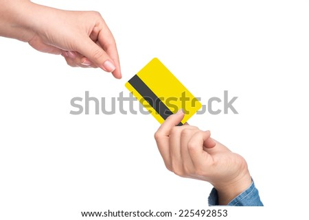 Young woman giving credit card to customer after purchase. Horizontal shape, closeup  - stock photo