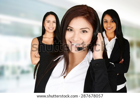 Young woman giving help as a customer service employee - stock photo