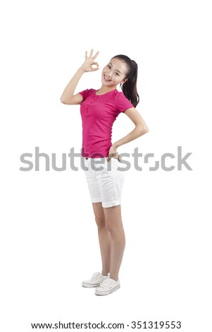 Young woman giving 'ok' gesture with hand, portraitbackground,portrait - stock photo