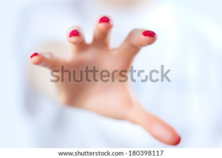 Young woman grabbing hand. On white. - stock photo