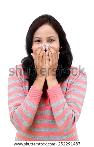 Young woman happy smile cover her mouth by hand palms - stock photo