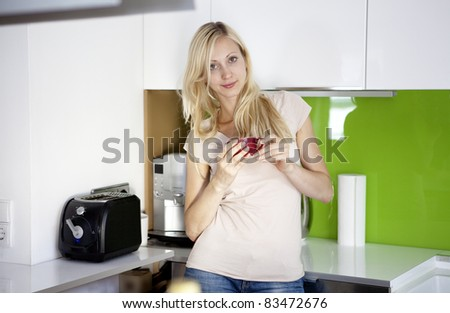 young woman has her coffee break at home - stock photo