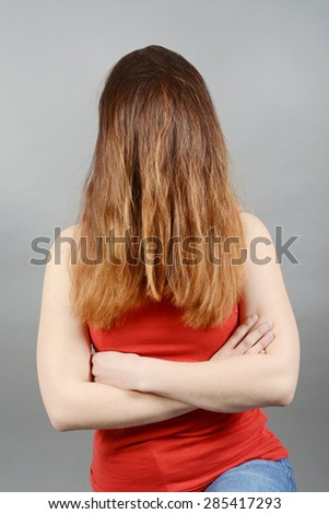 Young woman having a bad hair day - stock photo