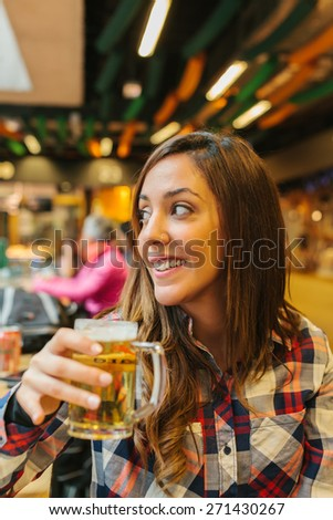 Young Woman Having a Beer in a Traditional Market - stock photo