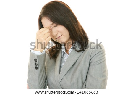 Young woman having a headache - stock photo