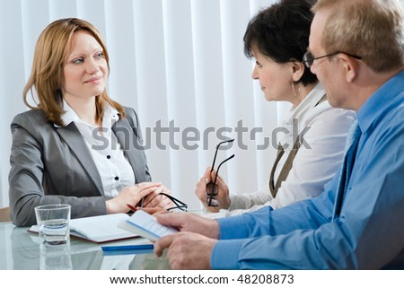 Young woman having a job interview in a office - stock photo