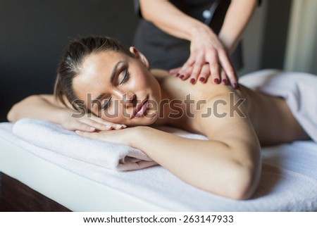 Young woman having a massage - stock photo