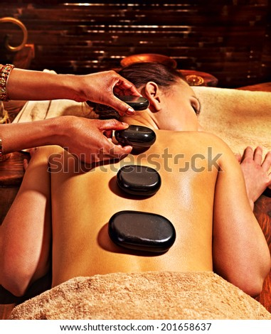 Young woman having Ayurveda stone massage. - stock photo