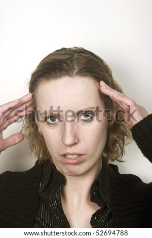 Young woman having bad migraine and feeling pain. holding her head. lots of free space above her. - stock photo
