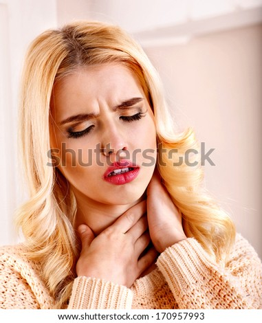 Young woman having  cold and sore throat. - stock photo