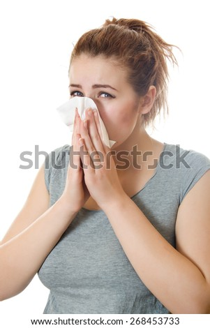 Young woman having flu or allergy. Isolated over white background. - stock photo