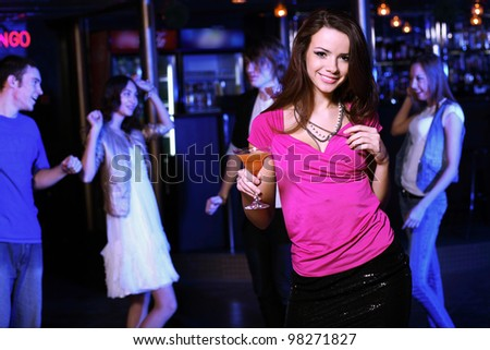 Young woman having fun and dancing at night club disco - stock photo