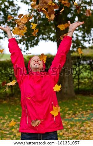 Young woman having fun in autumn - stock photo