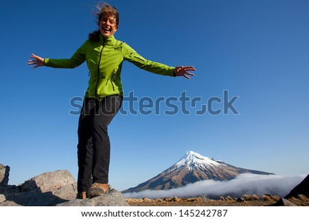 Young woman having fun in the mountains - stock photo