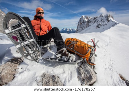 Young woman having fun on snowshoe hike - stock photo