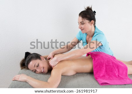 Young woman having massage - stock photo