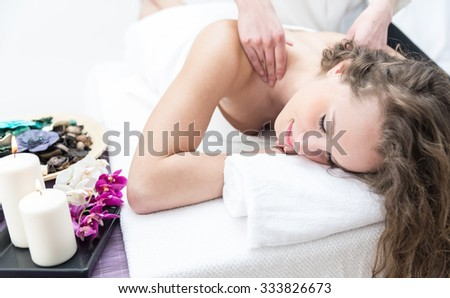 Young woman having massage in a beauty saloon - stock photo
