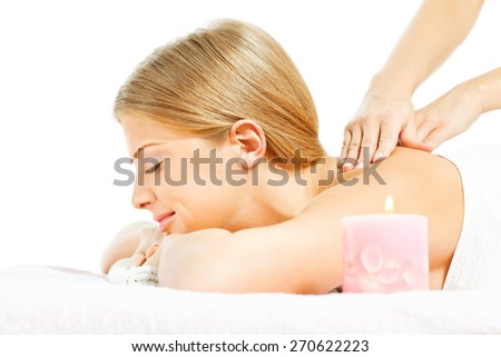 Young woman having massage on spa treatment - stock photo