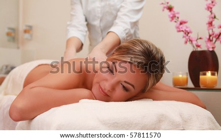 young woman having massage procedure - stock photo