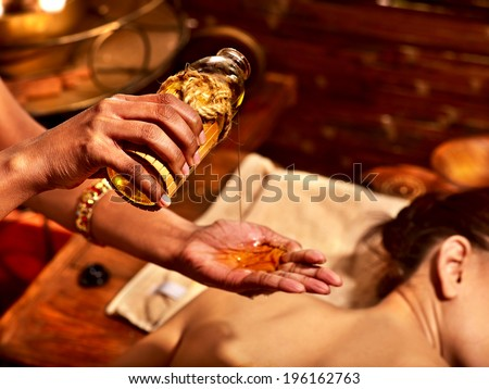 Young woman having oil massage spa treatment. - stock photo