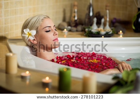 Young woman having treatment in spa center - stock photo