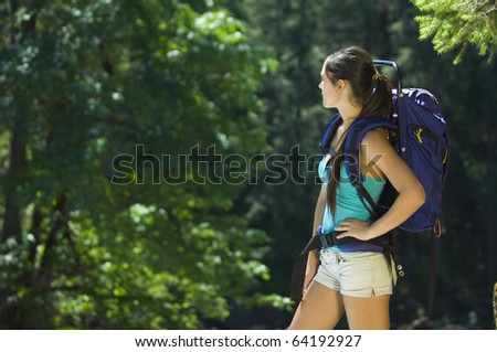 Young woman hiking in summer near Rogue River - stock photo