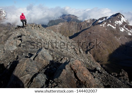 Young woman hiking in the mountains - stock photo