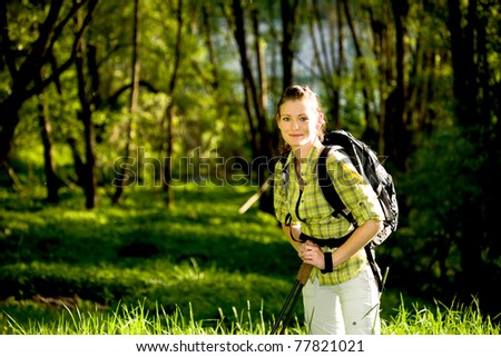 young woman Hiking In The Wild Nature - stock photo