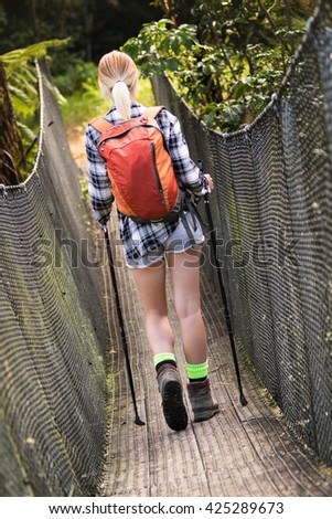 Young woman hiking with backpack - stock photo