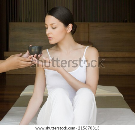 Young woman hold the cup of green tea - stock photo