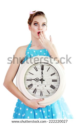 young woman holding a clock. time management concept. nine o`clock too late - stock photo