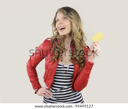 young woman holding a credit or gift card - stock photo