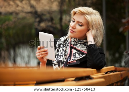 Young woman holding a digital tablet computer - stock photo