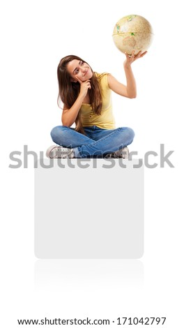 young woman holding a earth globe sitting on a white box on white - stock photo