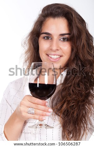 young woman holding a glass of wine and smiling - stock photo