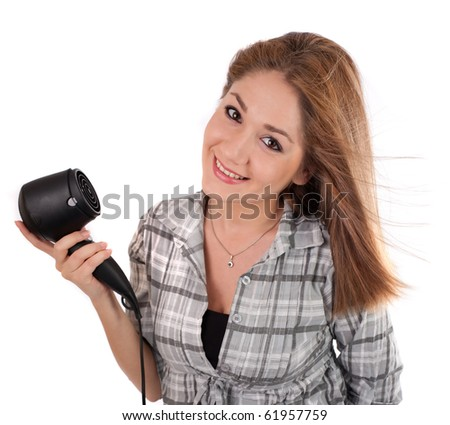 Young woman holding a hairdryer,isolated on white - stock photo