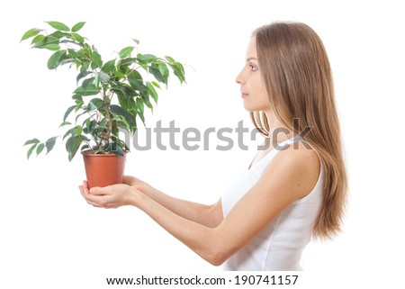 young woman holding a houseplant, isolated on white background - stock photo