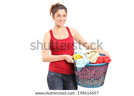 Young woman holding a laundry basket isolated on white background - stock photo