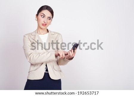 young woman holding a phone - stock photo
