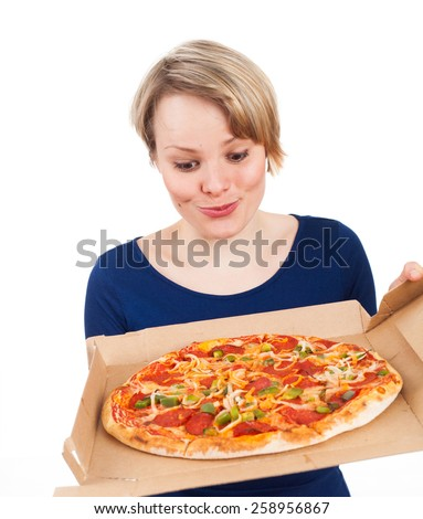 Young woman holding a pizza from fast food and looking very attracted, isolated on white - stock photo
