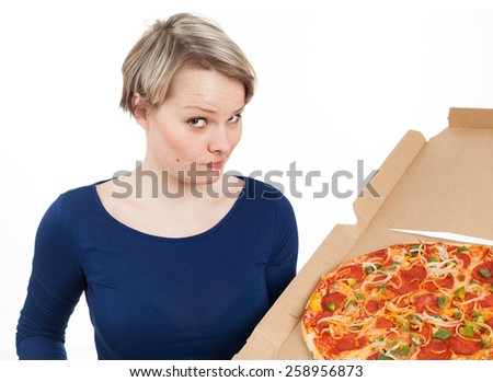 Young woman holding a pizza from fast-food with the desire of eating it, isolated on white - stock photo