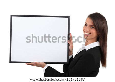 Young woman holding a publicity poster - stock photo