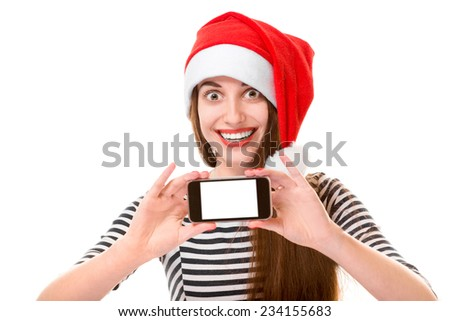 Young woman holding and showing mobile phone with empty screen on Christmas isolated on white background - stock photo