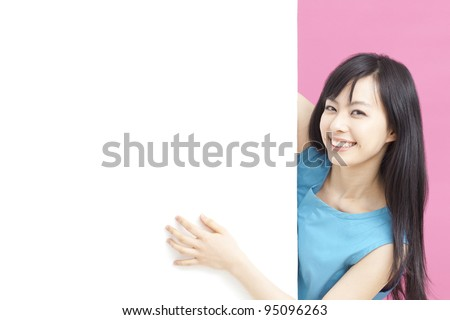 Young woman holding billboard. - stock photo